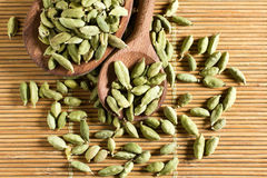 Cardamom. Spice cardamom seeds on the kitchen table Royalty Free Stock Photo