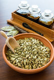 Cardamom in bowl. Cardamom in ceramic bowl on the table stock photos