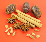 Cardamom, Cinnamon, star anise, dates Stock Photos