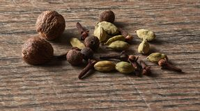 Cardamom, cloves, nutmeg, allspice. Different types of whole Ind stock photography