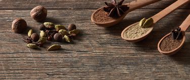 Cardamom, cloves, nutmeg, star anise, allspice. Different types royalty free stock photography