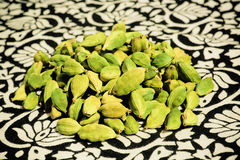 Cardamom on a patterned table cuisine Stock Photo