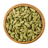 Cardamom pods in a bowl over white Royalty Free Stock Image