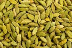 Cardamom seed pods background Stock Photo