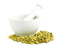 Cardamom seed pods with mortar Stock Photo