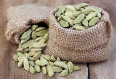 Cardamom seed in sack Royalty Free Stock Photos