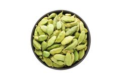 Cardamom seeds in clay bowl isolated on white background. Season Stock Photos