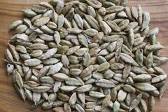 Cardamom seeds closeup. On the table Royalty Free Stock Images