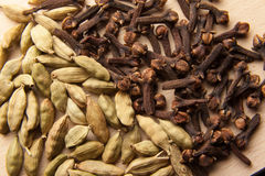 Cardamom seeds and cloves Royalty Free Stock Image