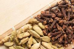 Cardamom seeds and cloves Stock Photography