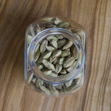 Cardamom seeds in a jar.  Stock Images
