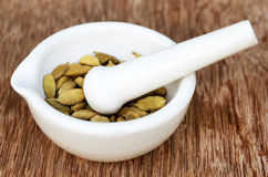 Cardamom seeds in a mortar Royalty Free Stock Photography