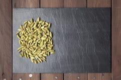 Free Cardamom Seeds On A Slate Plate With Copy Space Stock Photo - 42640910