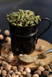 Cardamom seeds and powder. On a black background Royalty Free Stock Images