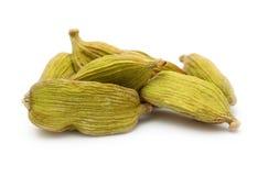 Cardamom seeds spice. On white background Stock Photos