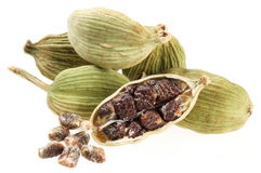 Cardamom seeds on a white. Stock Image