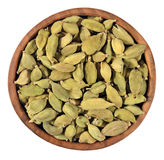 Cardamom seeds in a wooden bowl on a white Royalty Free Stock Photography