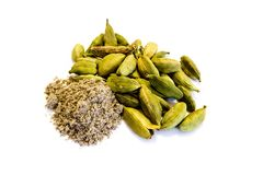 Cardamom spice and cardamom powder isolated on white background royalty free stock images