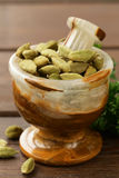 Cardamom  in a stone mortar Stock Image