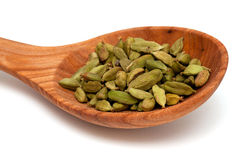 Cardamom in a wooden spoon Royalty Free Stock Photos