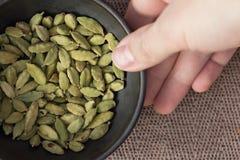 Cardamon in bowl Stock Photo
