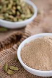 Cardamon Powder on wood Royalty Free Stock Images