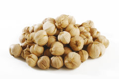 Cardamon seeds on white Stock Images