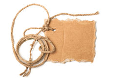 Cardboard. Piece of cardboard and rope with space for your text on white background Stock Photos