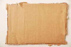 Cardboard. Torn section of a corrugated carton stock image