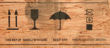 Cardboard. With keep dry icon and others Royalty Free Stock Photo