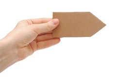 Cardboard arrow in a hand Royalty Free Stock Photo