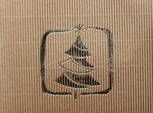 Cardboard background with golden christmas tree Royalty Free Stock Photos