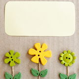 Cardboard Background With Green And Yellow Plastic Buttons Flowers And Leaves And Empty Copy Space For Text. Summer Background Stock Photos