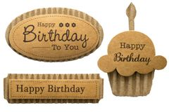 Cardboard birthday cutouts. Selection of birthday greeting corrugated cardboard templates isolated on white background stock photos