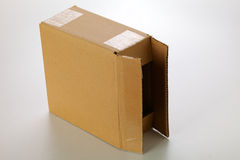 Cardboard box. A cardboard box isolated on grey background Royalty Free Stock Photography