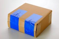 Cardboard box. A cardboard box isolated on grey background Stock Photography