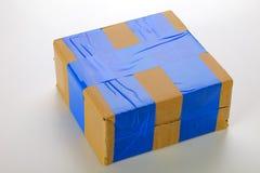 Cardboard box. A cardboard box  on grey background Stock Photo