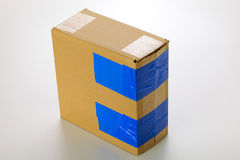 Cardboard box. A cardboard box isolated on grey background Royalty Free Stock Photos