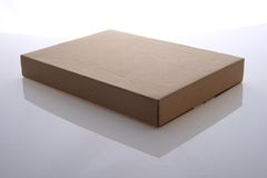 Cardboard box. Brown color cardboard box on white background Stock Photos