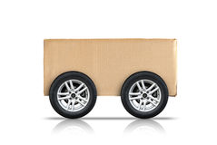 Cardboard box with automotive wheels isolated on white Royalty Free Stock Photo