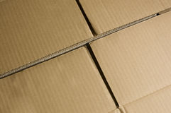 Cardboard box background. The surface of the cardboard box Royalty Free Stock Photo