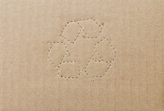 Cardboard box background with recycle symbol Royalty Free Stock Images