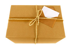 Cardboard box with blank message card label, manila brown envelope, isolated on white Stock Photography