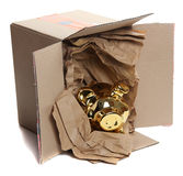 Cardboard box with brown paper and golden piggyban Royalty Free Stock Photo