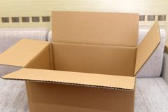 A cardboard box. In living room stock photography
