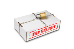 Cardboard box with chain and lock Royalty Free Stock Photo