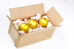 Cardboard box with christmas balls Stock Photo