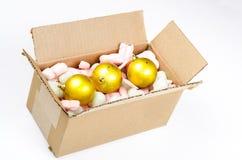 Cardboard box with christmas balls Stock Photo
