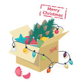 Cardboard box with Christmas decorations royalty free illustration