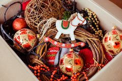 A cardboard box with christmas toys for for decorating Christmas tree. Concept of Christmas and New Year preparation. stock photography
